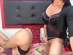 Two beautiful shemales having sex on cam