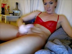 Good looking blonde shemale jerks off
