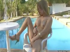 Here is a sexy latina whore by the pool masturbating