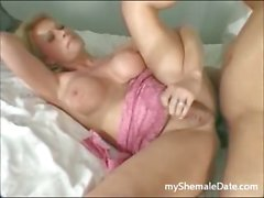 Beautiful blonde Shemale takes BBC