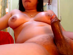Black Tgirl with big tits in solo action