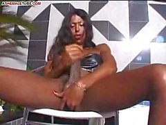 Dark haired shemale rub her monster cock