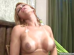 Honey blonde shemale strokes her fat shecock