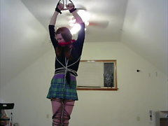 crossdresser in multiple bondage positions 3