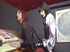 Two crossdressers fetish sex in an office