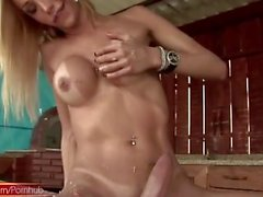 T-girl in bikini sharpens her cock on a hatchet and cums