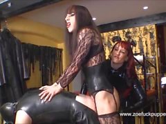 Horny crossdresser Zoe gives latex gimps her full 9 inches of cock