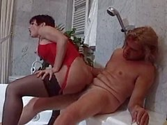 Shemale in red corset ride her man's beef stick