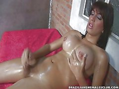 Barbara Vasconcelos oils herself and rubs her dick