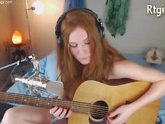 cute skinny tgirl play guitar for her fans